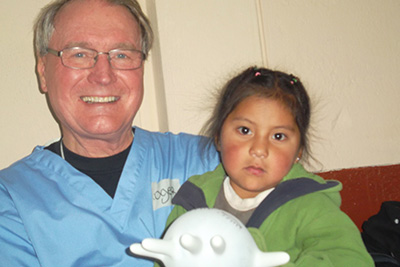Dr Roger Allan with one of the children that received dental care in Ecuador
